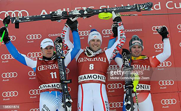 Alexis Pinturault of France takes 2nd place Romed Baumann of Austria takes 1st place Beat Feuz of Switzerland takes 3rd place during the Audi FIS...