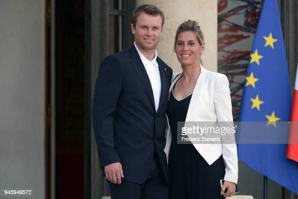 Alexis Pinturault skier silver medalist at the Pyeongchang Winter Olympics and his wife pose at the Elysee Palace after a cocktail hosted given by...