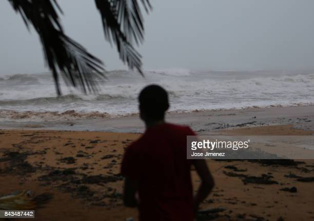 Alexis Ramos looks out to sea at Luquillo Beach prior to the passing of Hurricane Irma on September 6 2017 in San Juan Puerto Rico The category 5...