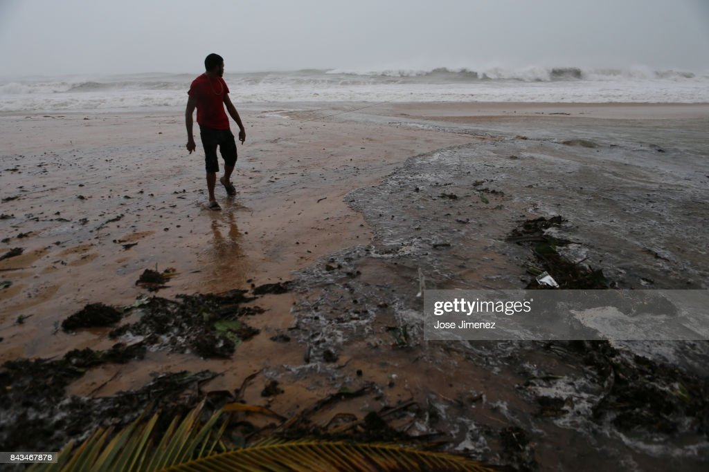 Alexis Ramos stands in the ocean at Luquillo Beach prior to the passing of Hurricane Irma on September 6, 2017 in San Juan, Puerto Rico. The category 5 storm is expected to pass over Puerto Rico and the Virgin Islands today, and make landfall in Florida by the weekend.