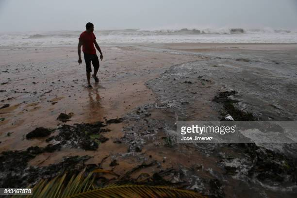 Alexis Ramos stands in the ocean at Luquillo Beach prior to the passing of Hurricane Irma on September 6 2017 in San Juan Puerto Rico The category 5...