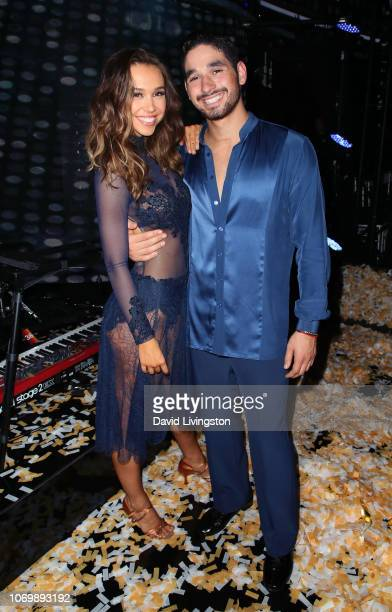 Alexis Ren and Alan Bersten pose at 'Dancing with the Stars' Season 27 Finale at CBS Television City on November 19 2018 in Los Angeles California