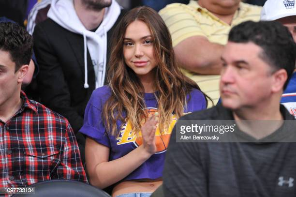 Alexis Ren attends a basketball game between the Los Angeles Lakers and the Golden State Warriors at Staples Center on January 21 2019 in Los Angeles...