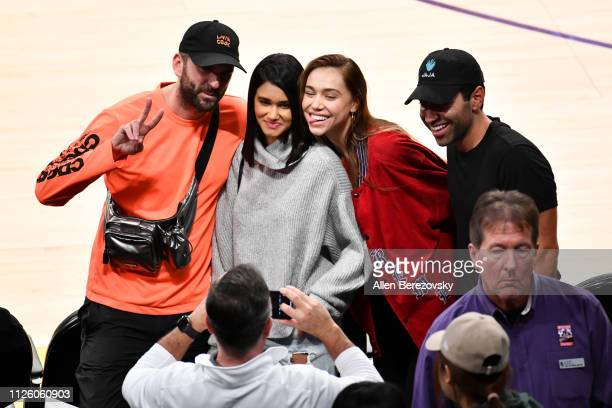 Alexis Ren poses for a picture with friends during a basketball game between the Los Angeles Lakers and the Philadelphia 76ers at Staples Center on...