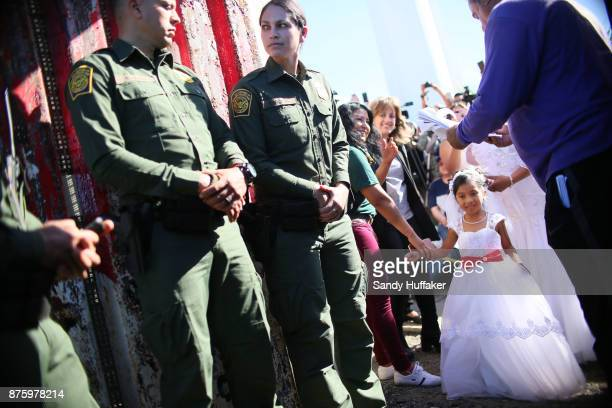 Alexis Reyes waits as Brian Houston who lives in San Diego walks towards she and her Mom Evelia Reyes who lives in Mexico while during a wedding...