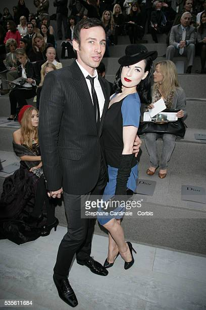 Alexis Roche and American stripper dancer and model Dita von Teese at the Christian Dior fashion show during Paris Fashion Week