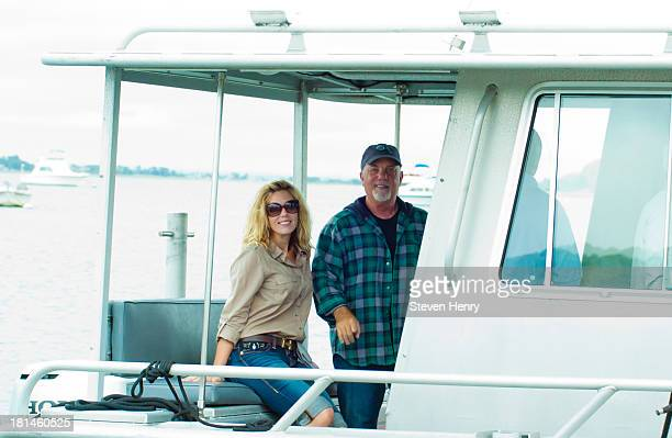 Alexis Roderick and Billy Joel attend Friends Of The Bay Cleanup at Theodore Roosevelt Park on September 21 2013 in Oyster Bay New York