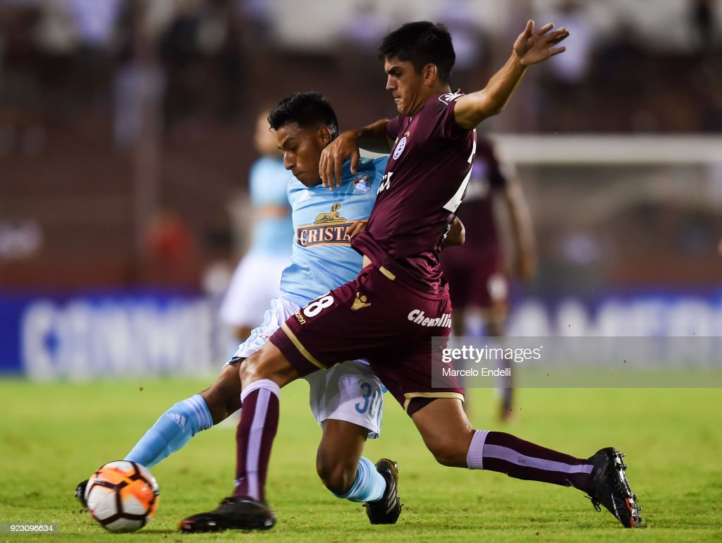 Alexis Rojas of Sporting Cristal fights for the ball with Enzo Ortiz of Lanus during a first leg match between Lanus and Sporting Cristal as part of first round of Copa CONMEBOL Sudamericana 2018 at Ciudad de Lanus Stadium on February 21, 2018 in Lanus, Argentina.