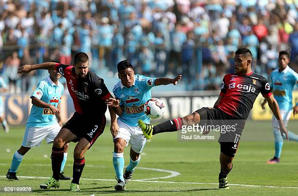 Alexis Rojas of Sporting Cristal struggles for the ball with Anderson Santamaria of FBC Melgar during a match between Sporting Cristal and FBC Melgar...