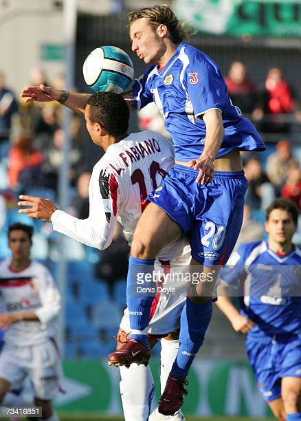 Alexis Ruano of Sevilla vies for the ball with Luis Fabiano of Getafe in the Primera Liga match between Getafe and Sevilla at the Coliseum Alfonso...