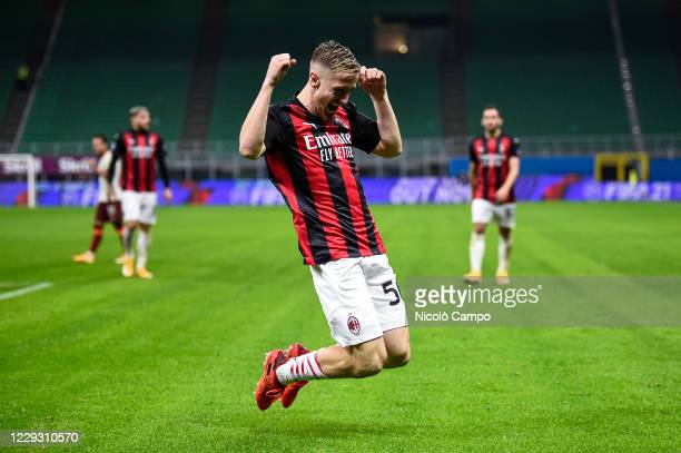 Alexis Saelemaekers of AC Milan celebrates after scoring a goal during the Serie A football match between AC Milan and AS Roma The match ended 33 tie