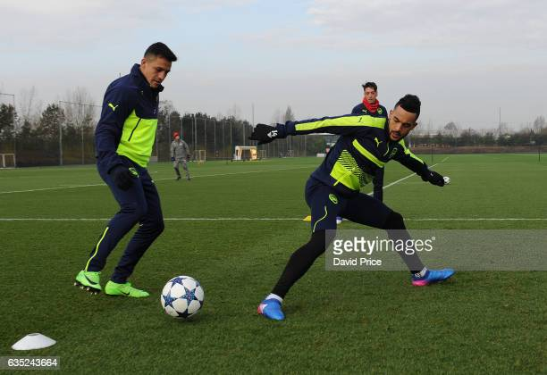 Alexis Sanche and Theo Walcott of Arsenal during the Arsenal Training Session at London Colney on February 14, 2017 in St Albans, England.