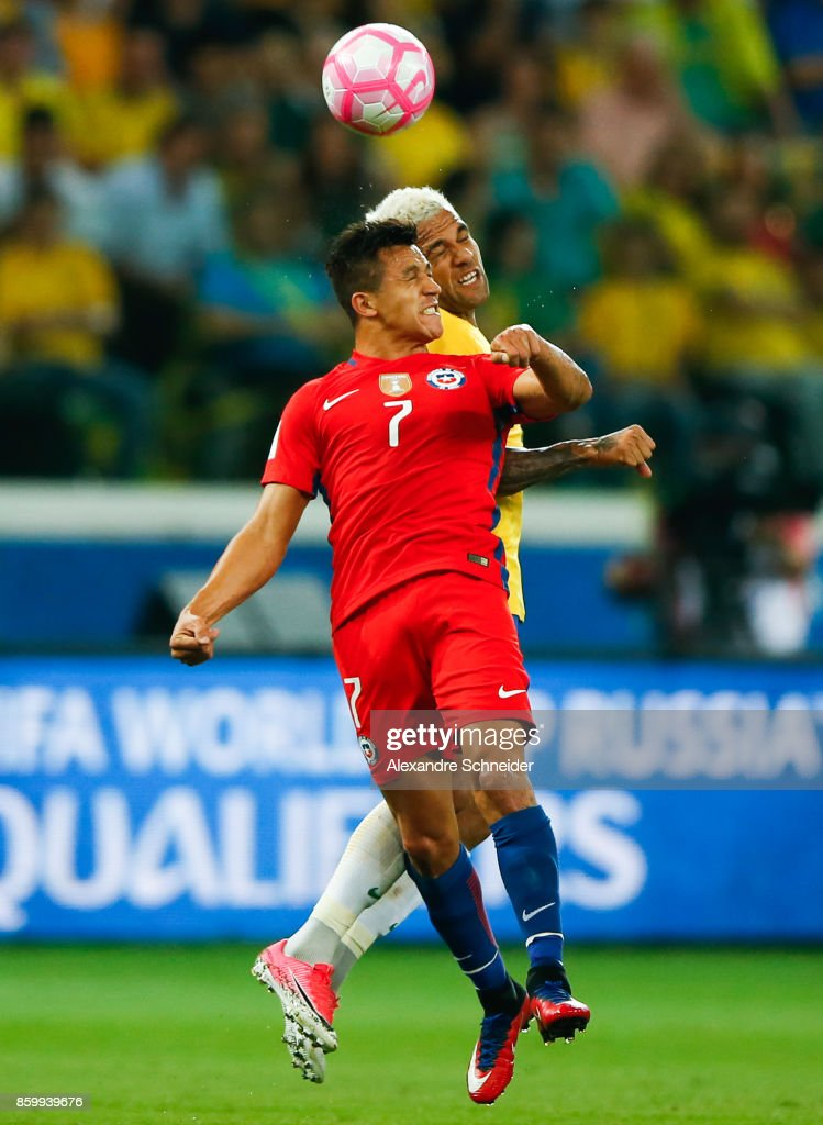 Alexis Sanches (L) of Chile and Daniel Alves of Brazil in action during the match between Brazil and Chile for the 2018 FIFA World Cup Russia Qualifier at Allianz Parque Stadium on October 10, 2017 in Sao Paulo, Brazil.