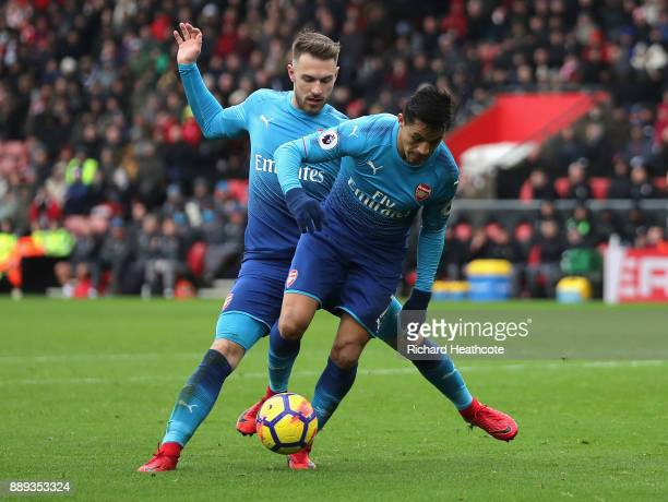 Alexis Sanchez and Aaron Ramsey of Arsenal clash during the Premier League match between Southampton and Arsenal at St Mary's Stadium on December 9...