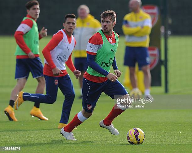 Alexis Sanchez and Aaron Ramsey of Arsenal during a training session at London Colney on October 31 2014 in St Albans England Photo by Stuart...
