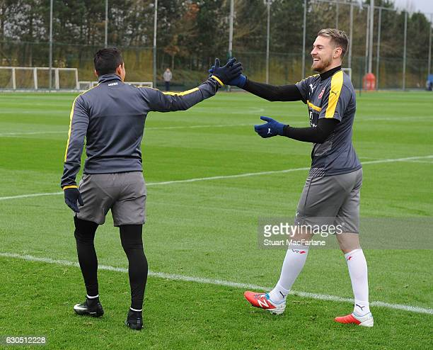 Alexis Sanchez and Aaron Ramsey of Arsenal during a training session at London Colney on December 25 2016 in St Albans England