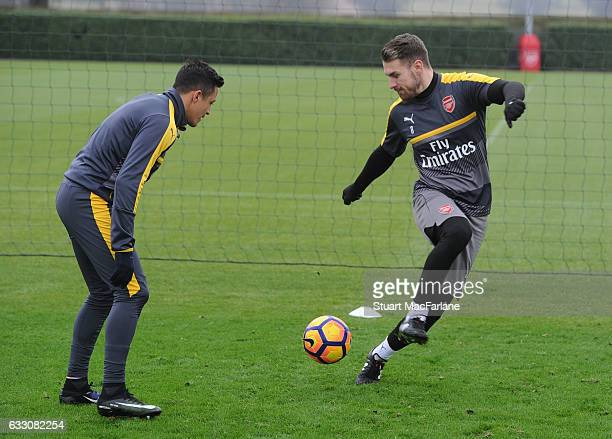 Alexis Sanchez and Aaron Ramsey of Arsenal during a training session at London Colney on January 30 2017 in St Albans England