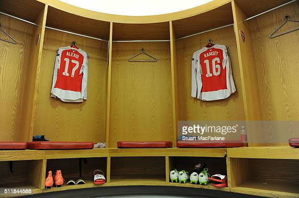 Alexis Sanchez and Aaron Ramsey's shirts hang in the Arsenal changing room before the UEFA Champions League Round of 16 1st leg match between Arsenal...