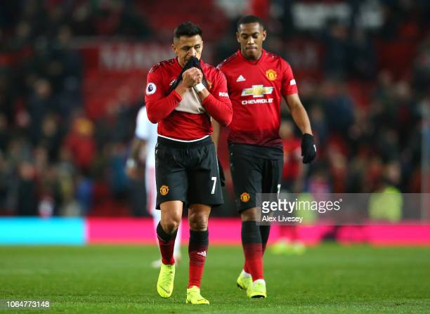 Alexis Sanchez and Anthony Martial of Manchester United look dejected following the Premier League match between Manchester United and Crystal Palace...