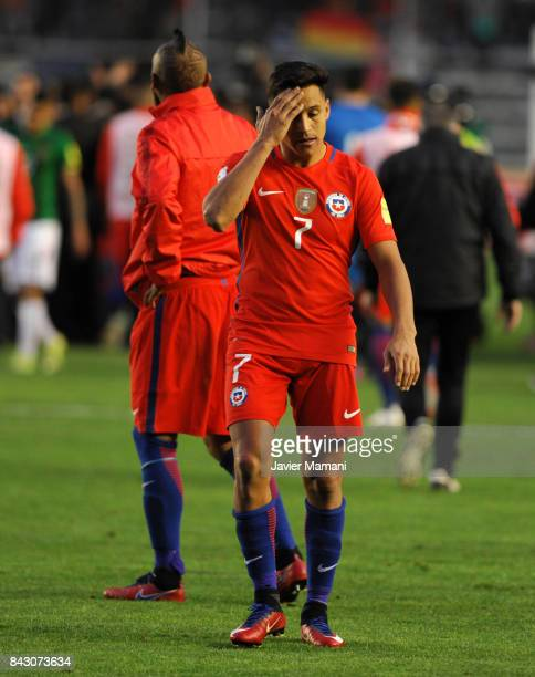 Alexis Sanchez and Arturo Vidal of Chile look dejected after losing a match between Bolivia and Chile as part of FIFA 2018 World Cup Qualifiers at...