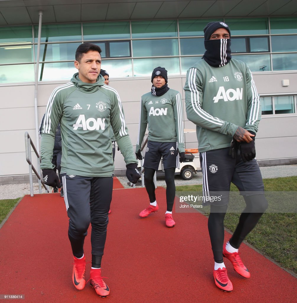 Alexis Sanchez and Ashley Young of Manchester United in action during a first team training session at Aon Training Complex on January 28, 2018 in Manchester, England.