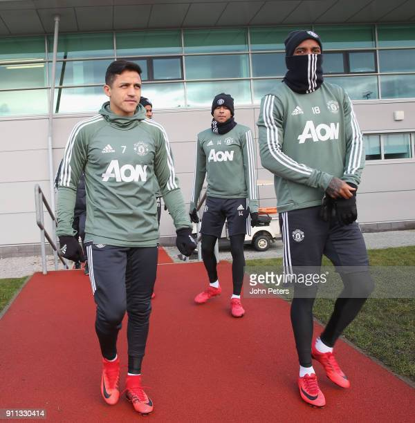 Alexis Sanchez and Ashley Young of Manchester United in action during a first team training session at Aon Training Complex on January 28 2018 in...