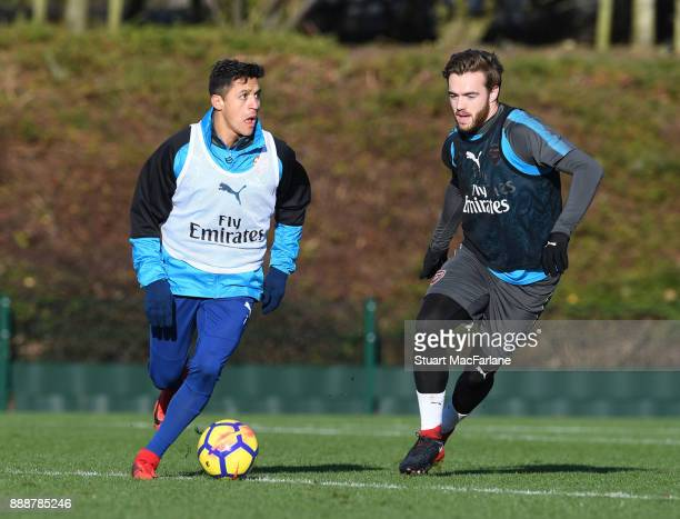 Alexis Sanchez and Calum Chambers of Arsenal during a training session at London Colney on December 9 2017 in St Albans England