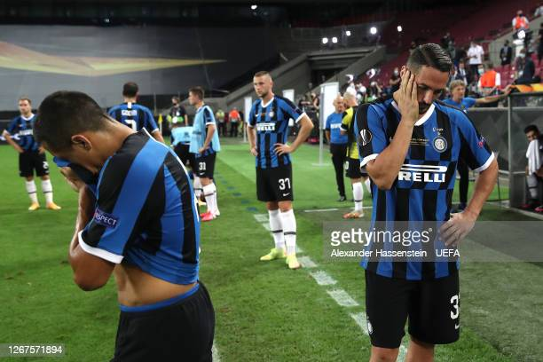 Alexis Sanchez and Danilo D'Ambrosio of Inter Milan look dejected following their team's defeat during the UEFA Europa League Final between Seville...