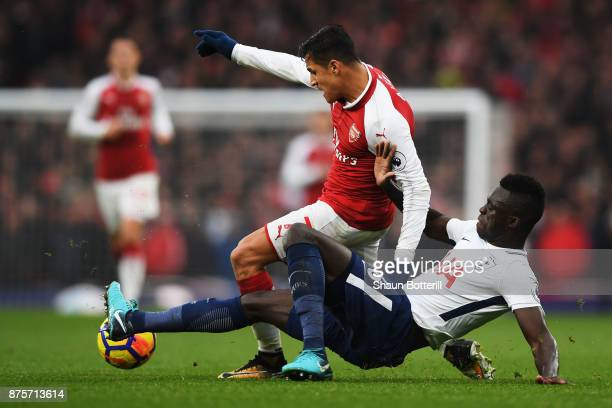 Alexis Sanchez and Davinson Sanchez of Tottenham Hotspur battle for possession during the Premier League match between Arsenal and Tottenham Hotspur...