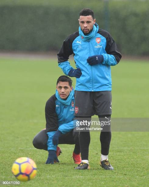 Alexis Sanchez and Francis Coquelin of Arsenal during a training session at London Colney on January 2 2018 in St Albans England