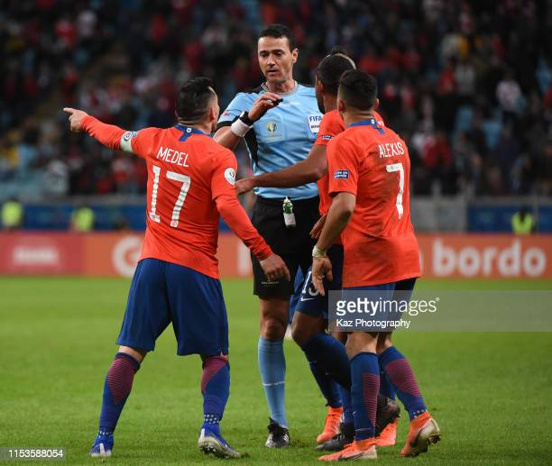 Alexis Sanchez and Gary Medel of Chile complain the referee Wilmar Roldan during the Copa America Brazil 2019 Semi Final match between Chile and Peru...