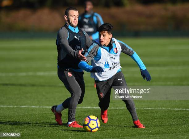 Alexis Sanchez and Jack Wilshere of Arsenal during a training session at London Colney on January 19 2018 in St Albans England