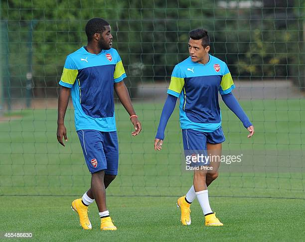 Alexis Sanchez and Joel Campbell of Arsenal during the Arsenal Training Session at London Colney on September 15 2014 in St Albans England