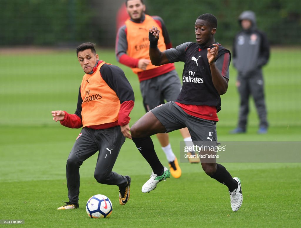 Alexis Sanchez and Joseph Olowu of Arsenal during a training session at London Colney on September 8, 2017 in St Albans, England.
