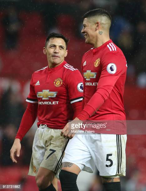 Alexis Sanchez and Marcos Rojo of Manchester United walk off after the Premier League match between Manchester United and Huddersfield Town at Old...