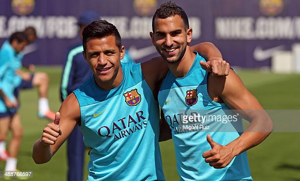 Alexis Sanchez and Martin Montoya of FC Barcelona say hello to the camera during the training session at Ciutat Esportiva on May 8 2014 in Barcelona...