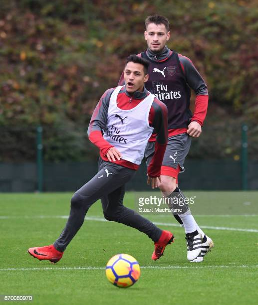 Alexis Sanchez and Mathieu Debuchy of Arsenal during a training session at London Colney on November 4 2017 in St Albans England