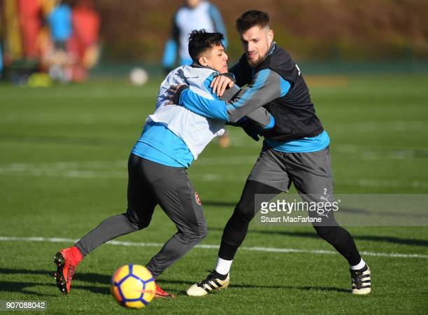 Alexis Sanchez and Mathieu Debuchy of Arsenal during a training session at London Colney on January 19 2018 in St Albans England