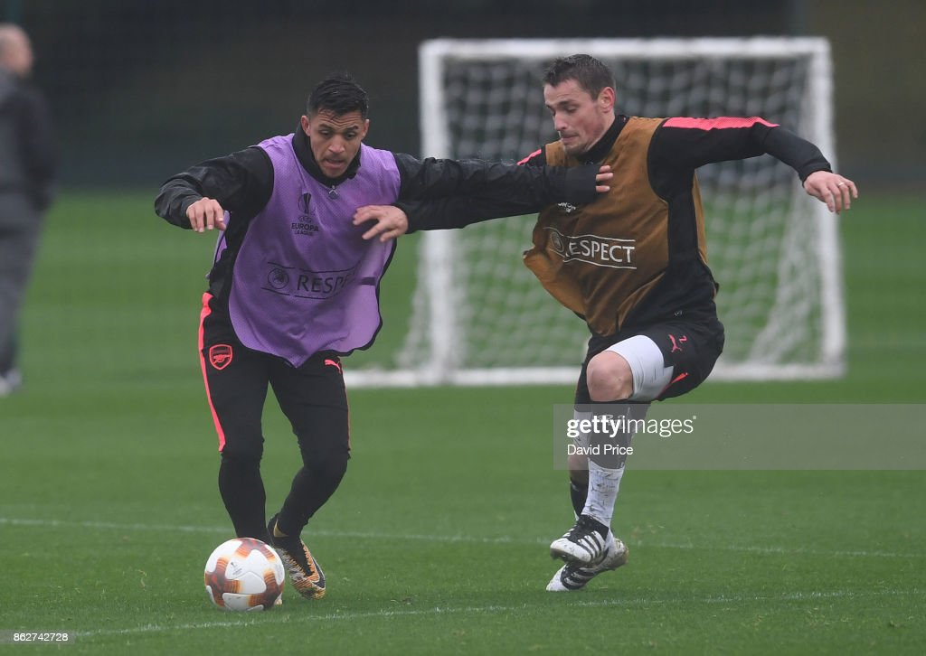 Alexis Sanchez and Mathieu Debuchy of Arsenal during the Arsenal Training Session at London Colney on October 18, 2017 in St Albans, England.