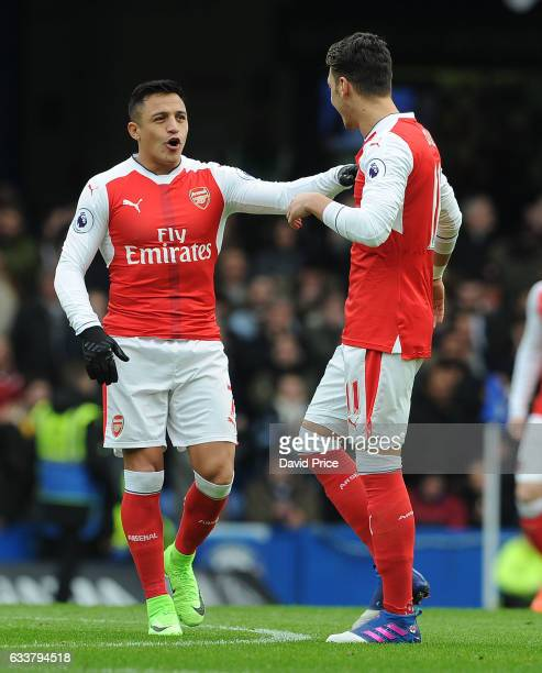 Alexis Sanchez and Mesut Ozil of Arsenal before the Premier League match between Chelsea and Arsenal at Stamford Bridge on February 4 2017 in London...