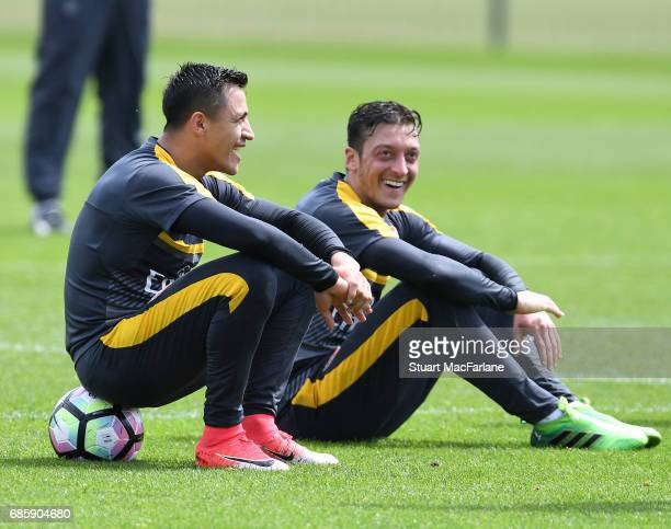 Alexis Sanchez and Mesut Ozil of Arsenal during a training session at London Colney on May 20 2017 in St Albans England