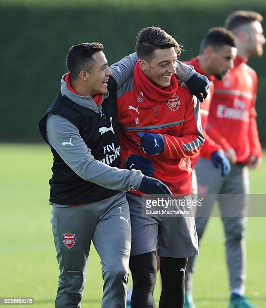 Alexis Sanchez and Mesut Ozil of Arsenal during a training session in preparation for the Premier League match against AFC Bournemouth at London...