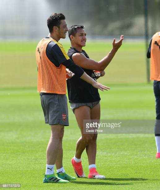 Alexis Sanchez and Mesut Ozil of Arsenal during the Arsenal Training Session at London Colney on May 24 2017 in St Albans England