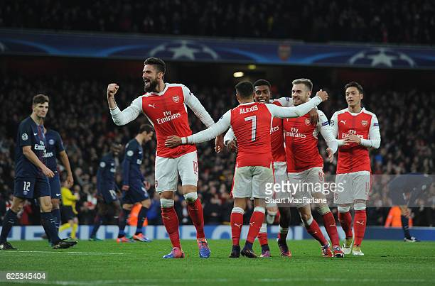 Alexis Sanchez and Olivier Giroud celebrate the 2nd Arsenal goal during the UEFA Champions League match between Arsenal FC and Paris SaintGermain at...