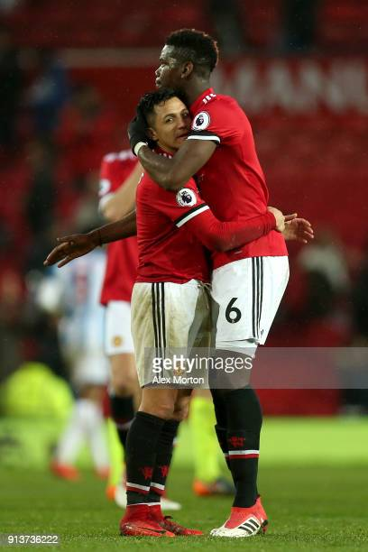 Alexis Sanchez and Paul Pogba of Manchester United embrace following the Premier League match between Manchester United and Huddersfield Town at Old...