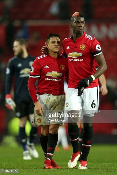Alexis Sanchez and Paul Pogba of Manchester United leave the pitch following the Premier League match between Manchester United and Huddersfield Town...