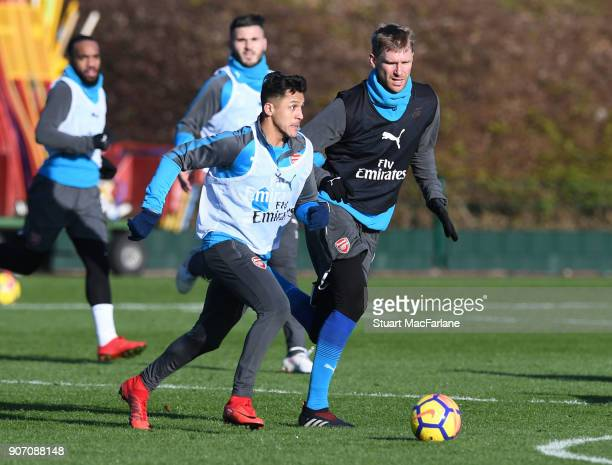 Alexis Sanchez and Per Mertesacker of Arsenal during a training session at London Colney on January 19 2018 in St Albans England