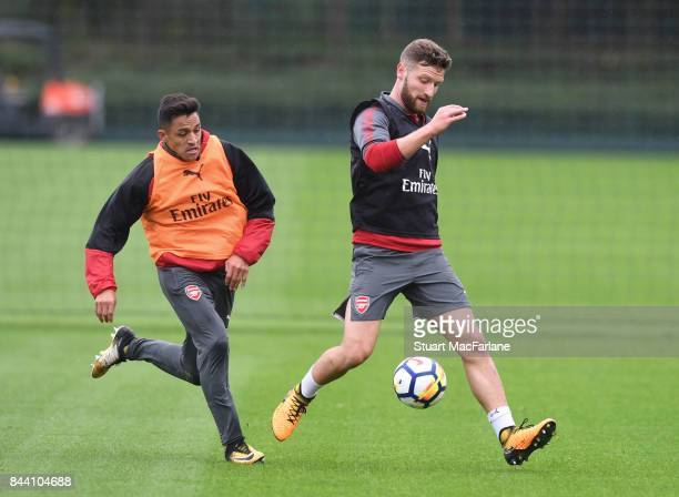 Alexis Sanchez and Shkodran Mustafi of Arsenal during a training session at London Colney on September 8 2017 in St Albans England