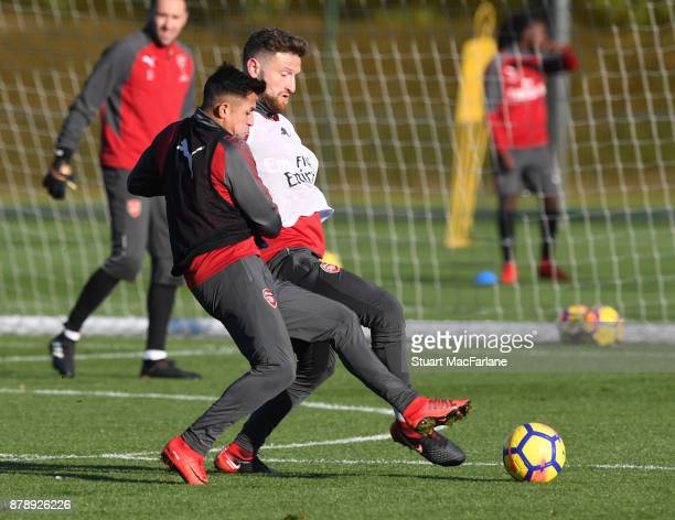 Alexis Sanchez and Shkodran Mustafi of Arsenal during a training session at London Colney on November 25 2017 in St Albans England