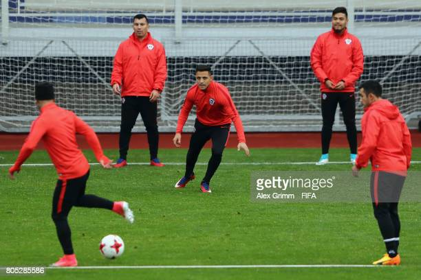 Alexis Sanchez and team mates exercise during a Chile training session ahead of their FIFA Confederations Cup Russia 2017 final against Germany at...